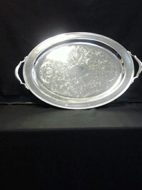 Where to find TRAY, 21X15 SILVER OVAL W HAND in Tulsa