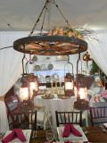 Rental store for LIGHT, RUSTIC WAGON WHEEL CHANDELIER in Tulsa OK